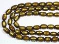 【天然石カットビーズ】ゴールデンキャッツアイ珊瑚 太鼓型 約10×14mm【天然石 パワーストーン】