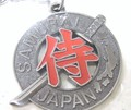 ◇日本製◇【外国人の日本土産として最適 !!】丸メタル「侍」 キーホルダー (ゴールド・ブラック)