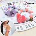 ★2016年ニコプチ10月号掲載商品★【Le cocone】パステル×レースアップハートボールブレスレット