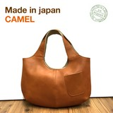 UN SIGNET Leather Handbag